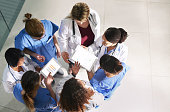High angle shot of a group of medical practitioners analyzing data in a hospital