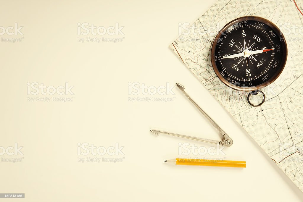 Finding your way with compass, map, pencil, and dividers royalty-free stock photo