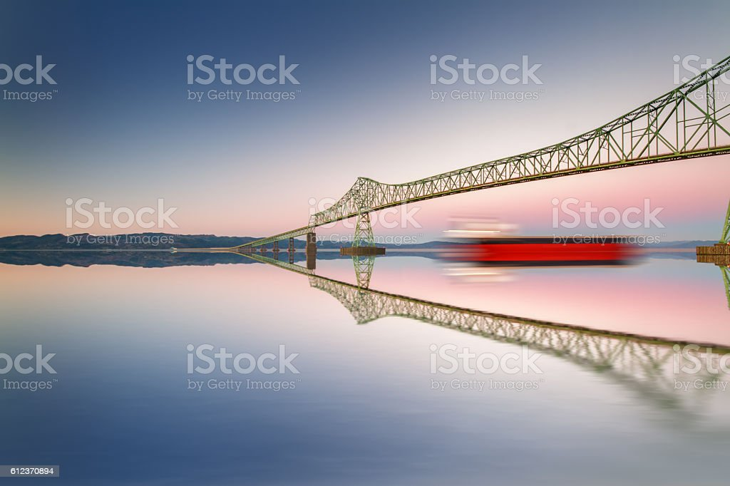 Fine art bridge and ship in clear sky with reflections stock photo