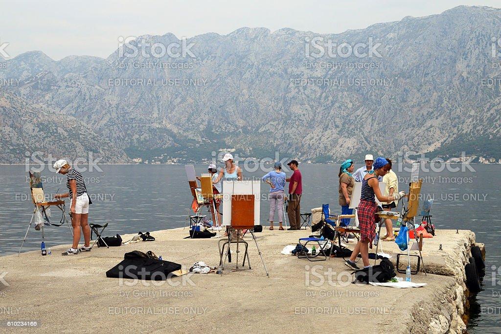 Fine art class on a pier near Kotor, Montenegro stock photo