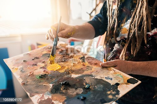 istock Fine art painter creating a new masterpiece 1053904172