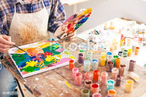 istock Fine art painter creating a new masterpiece 523827170