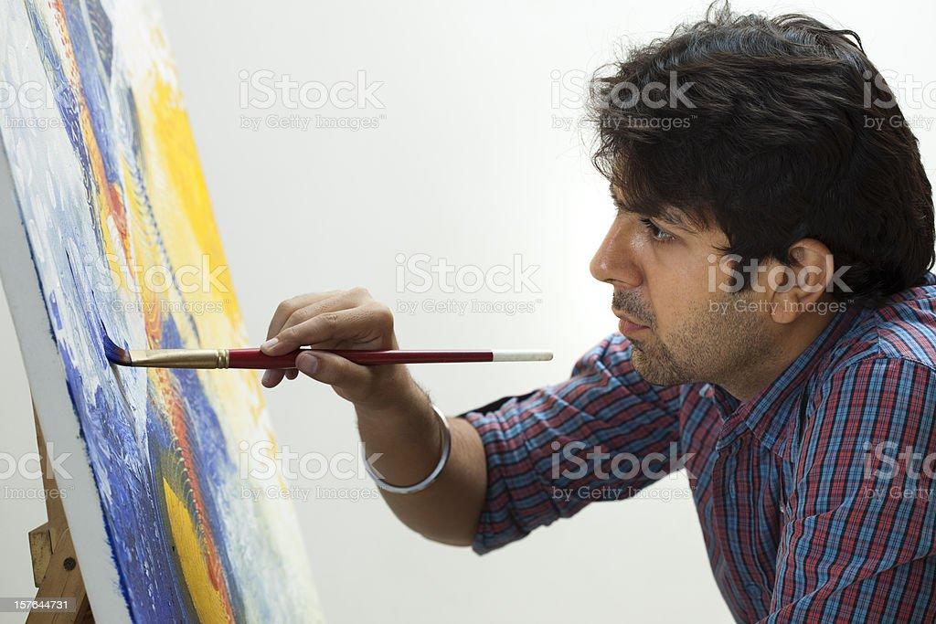 fine art painter painting on canvas stock photo