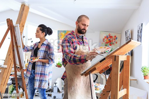 824254912 istock photo Fine art painters working in atelier together 688348410