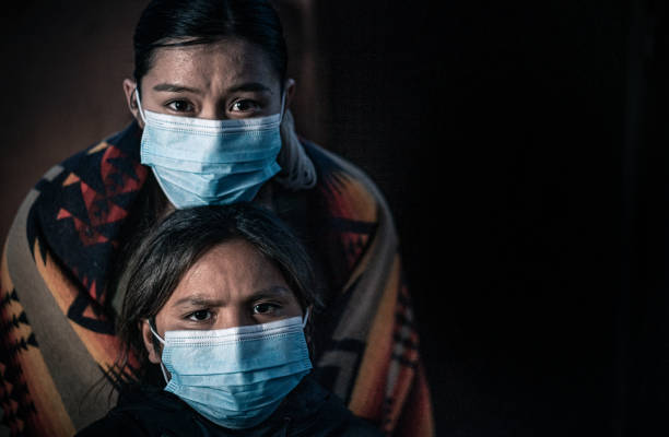 A Fine Art Portrait Of A Fearful Native American Sister And Her Little Brother, Wearing Protective Masks From Covid19 stock photo