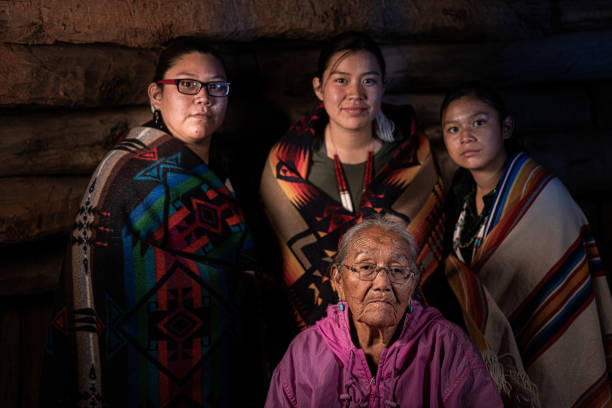 A Fine Art Portrait of A Native American Grandmother And Her Three Granddaughters In Their Family Hogan stock photo