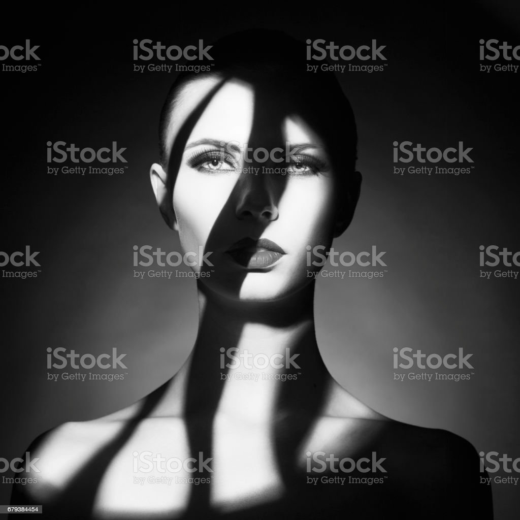 Fine art portrait of elegant lady with shadows on her face stock photo