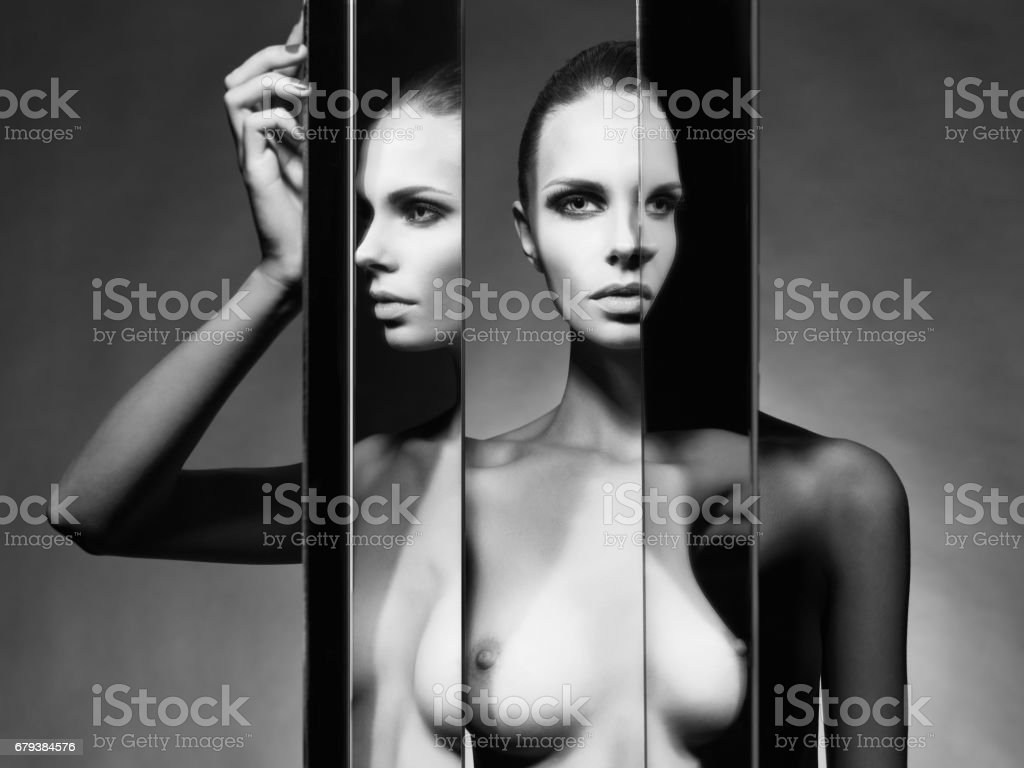 Fine art portrait of elegant nude lady with mirror royalty-free stock photo