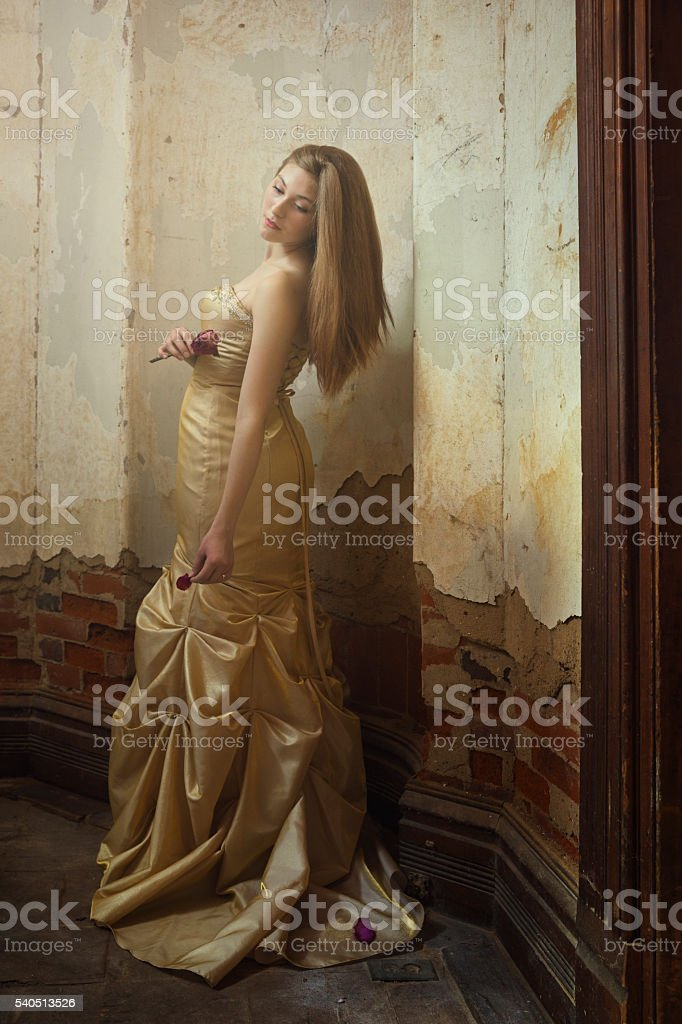 Fine art portrait young woman in old house stock photo