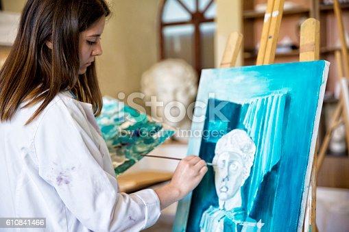 istock Fine art students painting 610841466