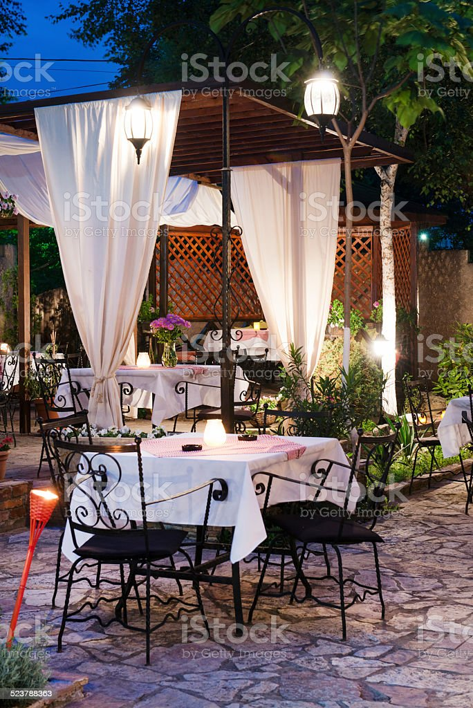 Fine Banquet Table Setting With Candles in Outdoor Night Reastaurant stock photo