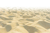 Fine beach sand in the summer sun on white