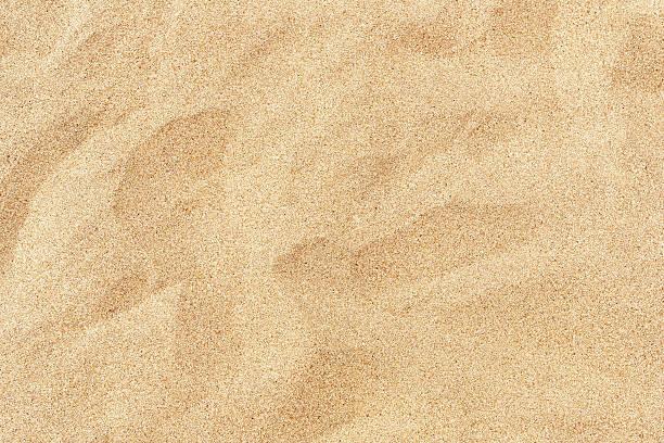 plaży piasek w letnie słońce - piasek zdjęcia i obrazy z banku zdjęć