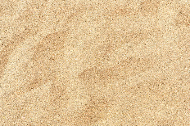 Fine beach sand in the summer sun A beach background with fine sand sand stock pictures, royalty-free photos & images