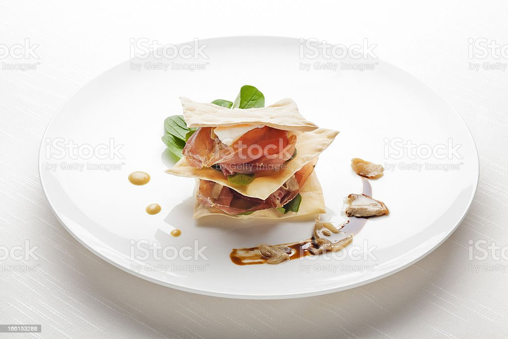 Fine Dining Appetizer: Millefoglie di San Daniele e Porcini Marinati royalty-free stock photo