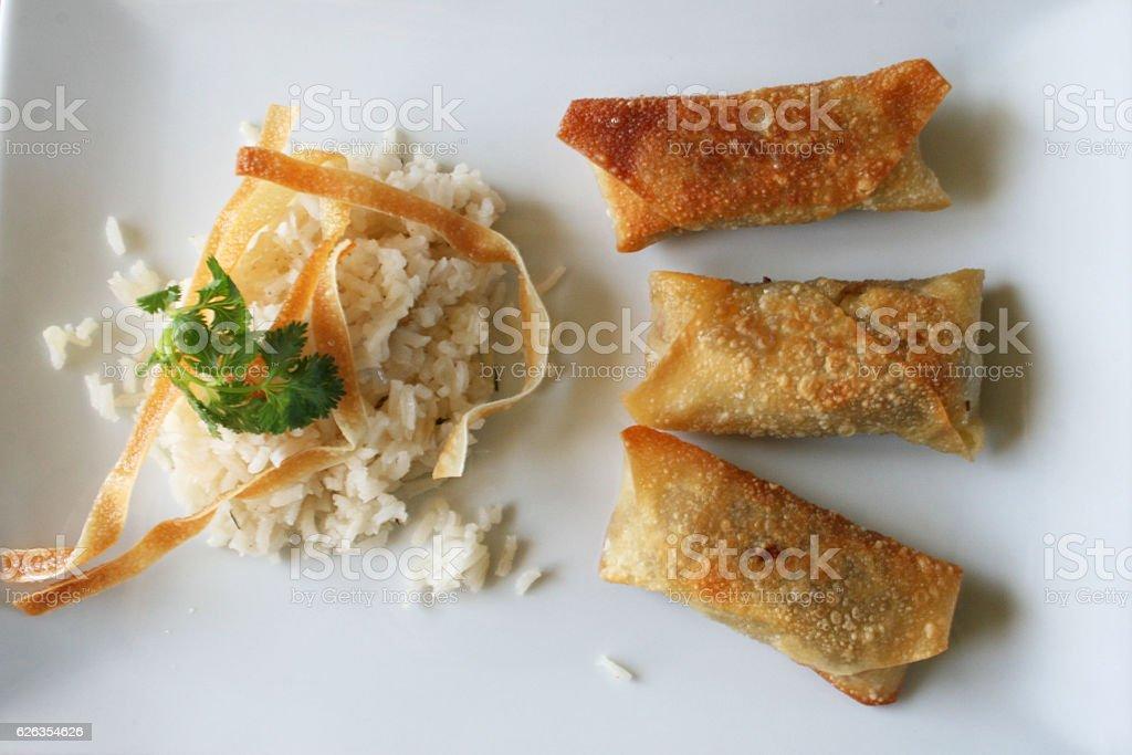 Fine Dining Asian Cuisine - Egg Rolls & White Rice stock photo