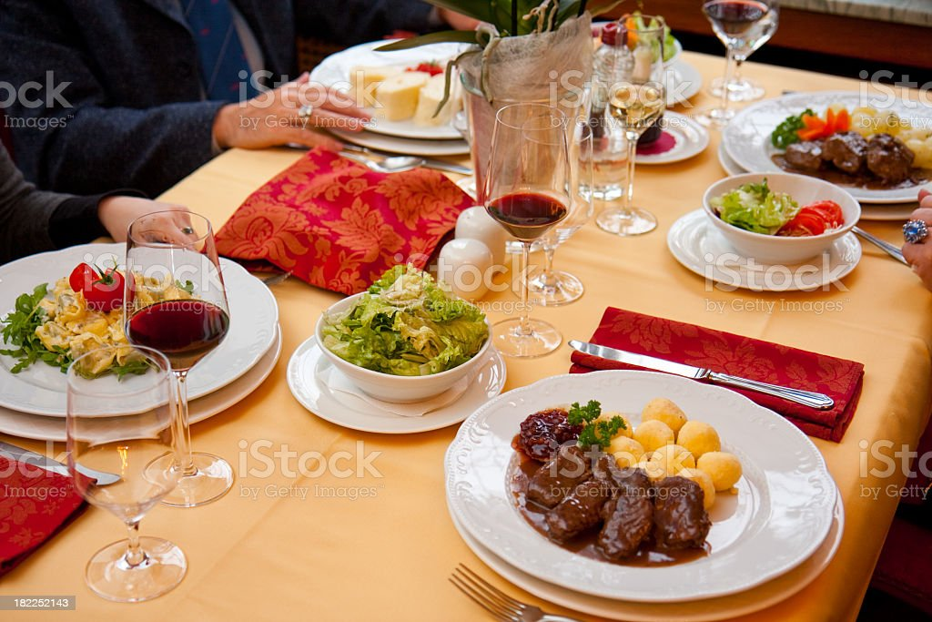 Group of people having delicious dinner