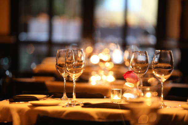 Fine Dining Elegant table settings with candles and roses fine dining stock pictures, royalty-free photos & images