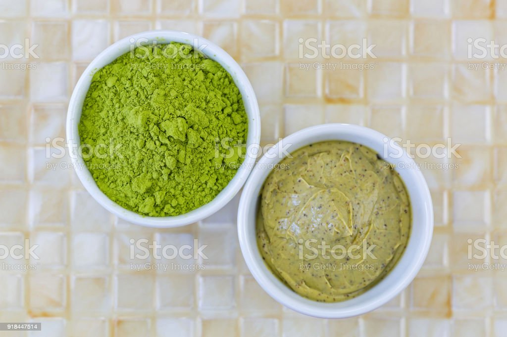 Fine Ground Japanese Matcha green tea leaves powder, Green tea scrub with walnut shell and Cocoa exfoliator stock photo