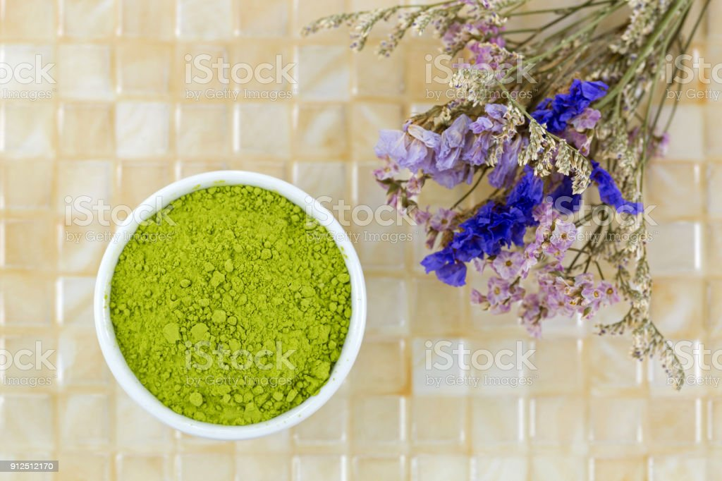 Fine Japanese Matcha green tea powder on yellow tile background stock photo