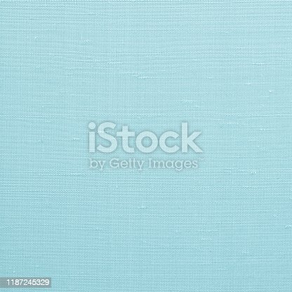 859441184 istock photo Fine natural cotton silk fabric wallpaper texture pattern background in light pastel cyan blue color tone 1187245329