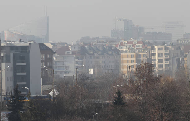 Fine particulate matter air in the city and PM2.5 dust. Cityscape of buildings with bad weather from Fine Particulate Matter. Air pollution. stock photo