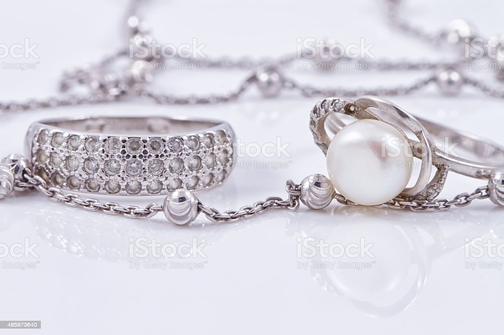 Fine silver rings and unusual silver chain stock photo
