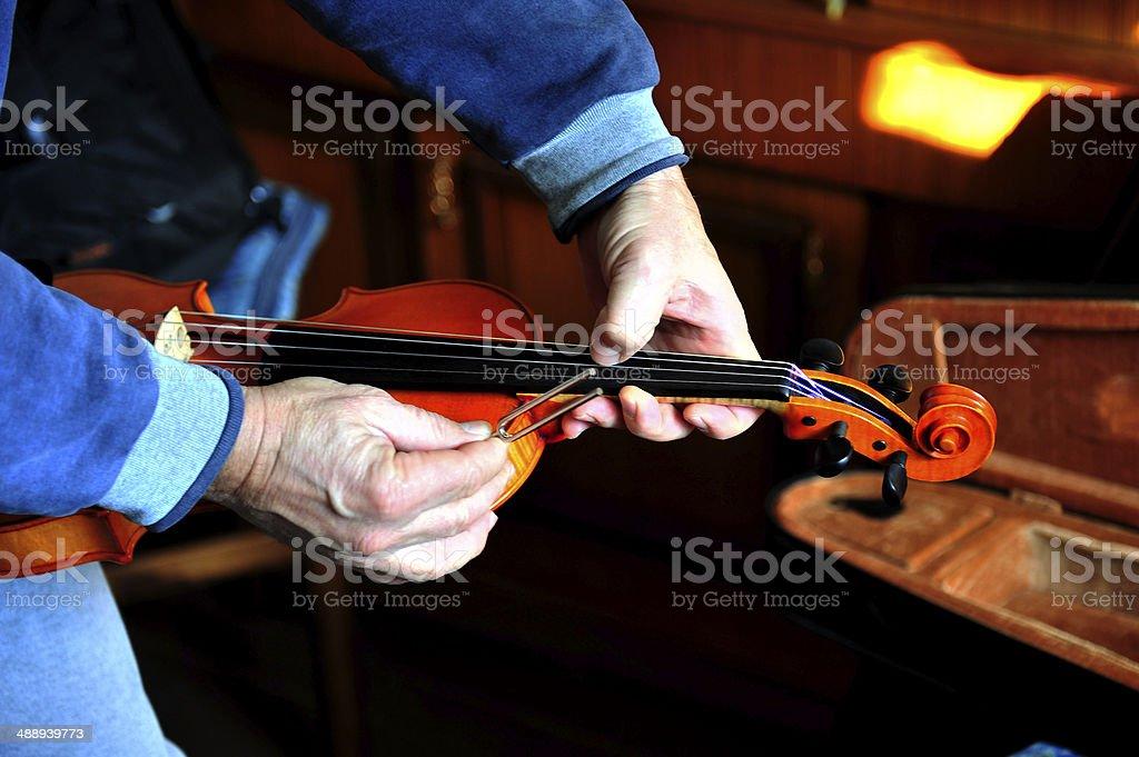 Fine tuning violin stock photo