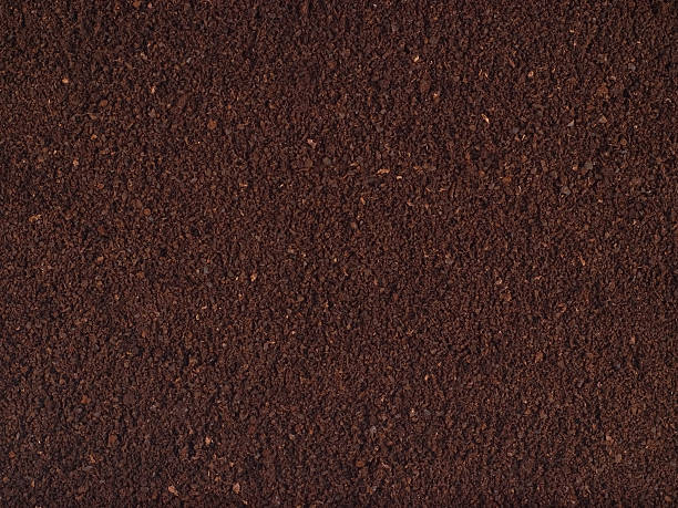 Finely Ground Coffee Texture Crisp and detailed look at the main ingredient of everyone's favorite cafeinated beverage - coffee! Great texture or background for coffee lovers. grinding stock pictures, royalty-free photos & images