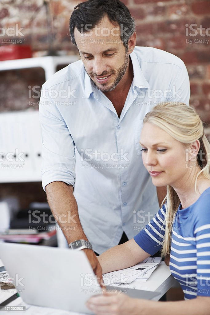 Fine-tuning their designs together stock photo