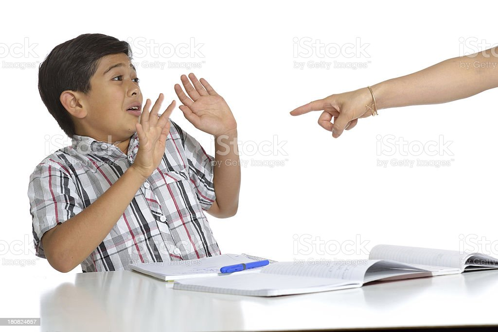 Finger accusing and blaming preteen boy in class stock photo