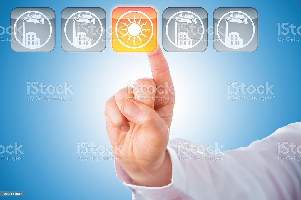 Finger Activating Yellow Solar Energy Icon On Blue stock photo