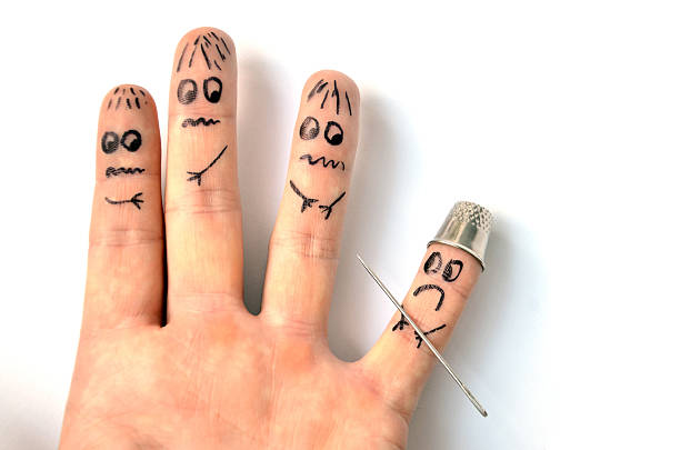 Finger armed by needle puts in fear another fingers - foto de stock