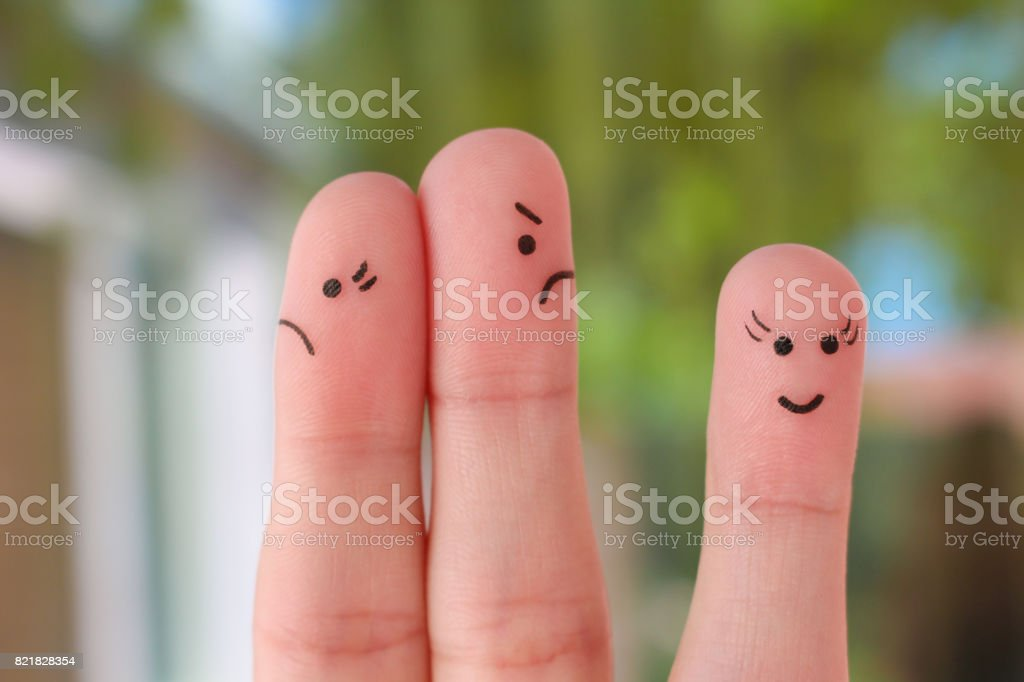 Finger art of family during quarrel. A couple arguing, another woman is happy. stock photo