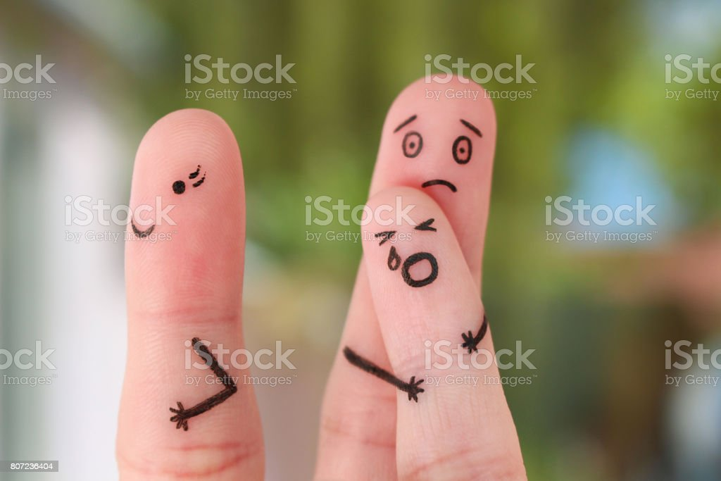 Finger art of family during quarrel. Concept of child remained with father, mother left to go out. Baby cries. stock photo