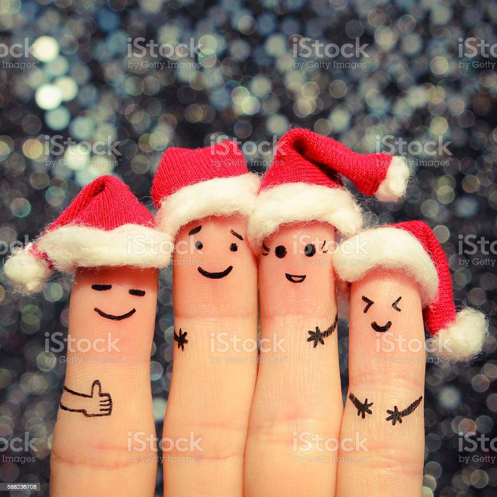 Finger art of friends celebrates Christmas. stock photo