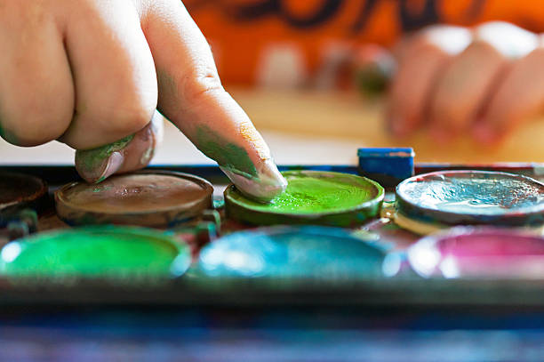finger at watercolour paint - fingerfarben stock-fotos und bilder