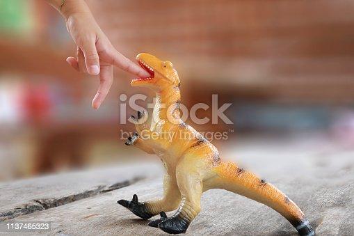istock Finger bite by dinosaurs 1137465323