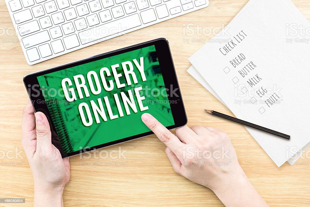 Finger click screen with Grocery online word stock photo