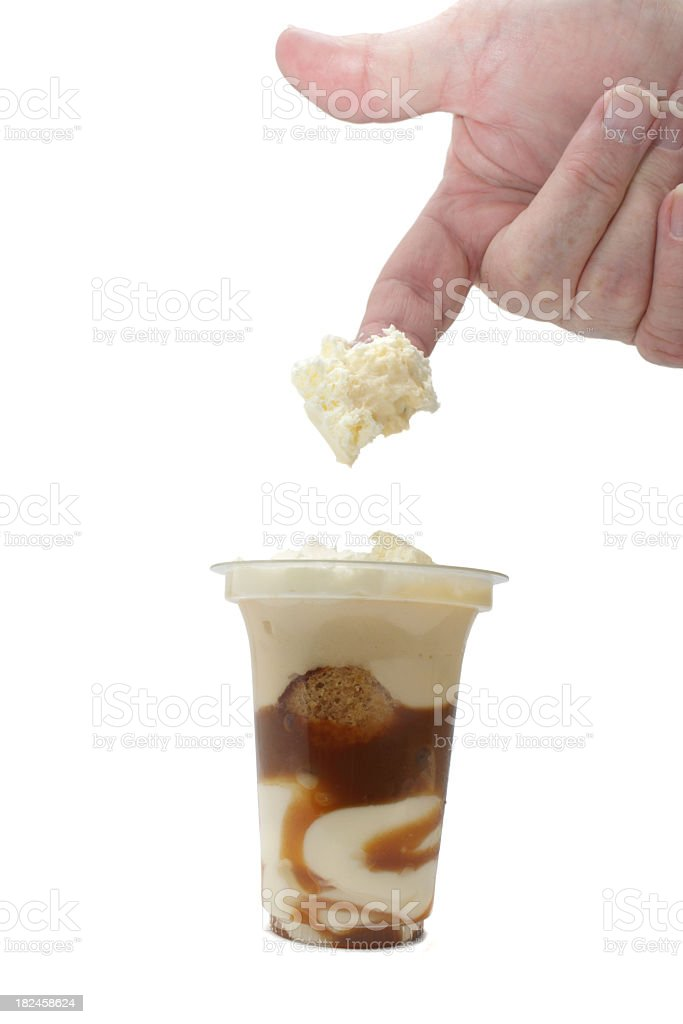 finger dips toffee flavour cream dessert in plastic container royalty-free stock photo