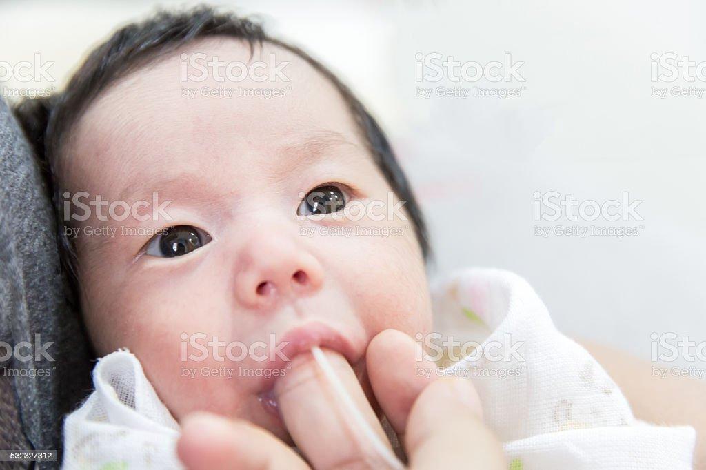 Finger Feeding baby stock photo