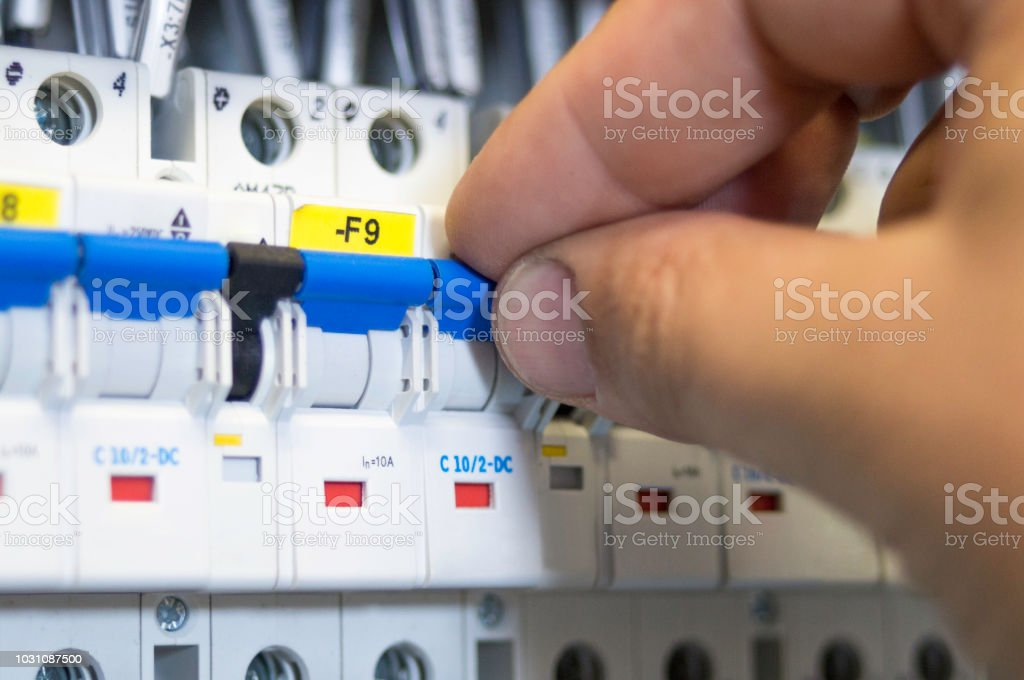 Finger Flipping Switch On Fusebox Up Or Down Stock Photo - Download on
