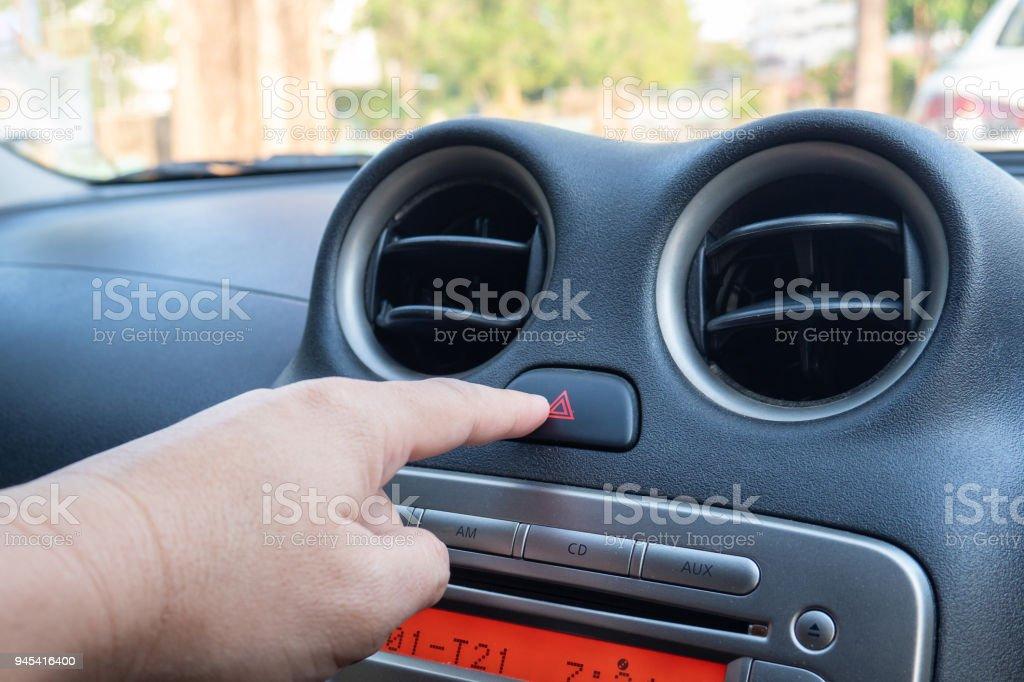 Dedo, bater o carro de emergência luz botton - foto de acervo