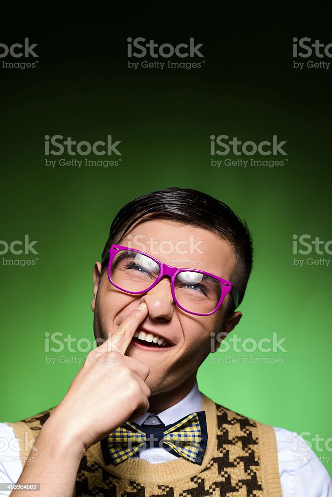 finger in nose stock photo