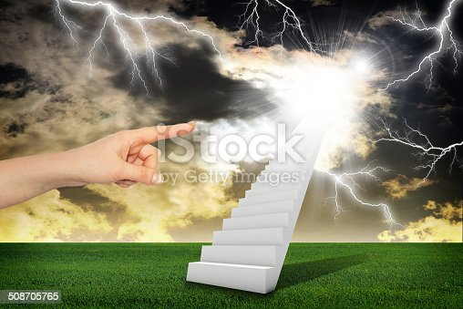 Finger indicates stairway with green grass and thunderstorm. Concept background