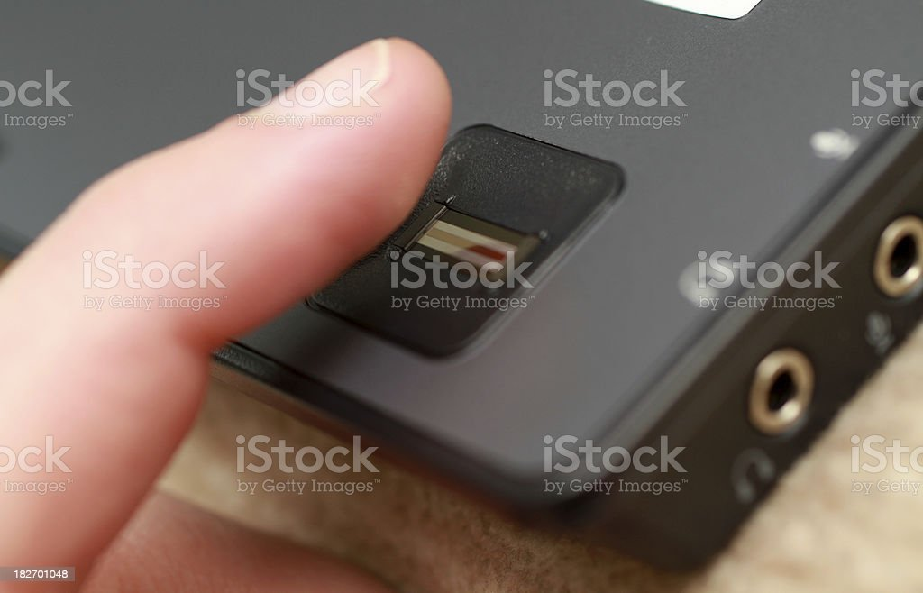 Finger moving over a sensor of notebook stock photo