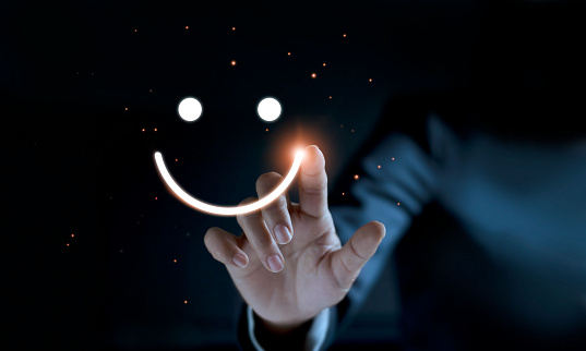 istock Finger of businessman touching and drawing face emoticon smile on dark background, service mind, service rating. Satisfaction and  customer service concept. 1127257331