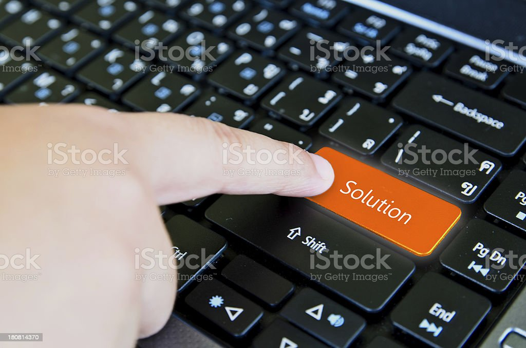 Finger of chind pushing the button Solution keyboard royalty-free stock photo
