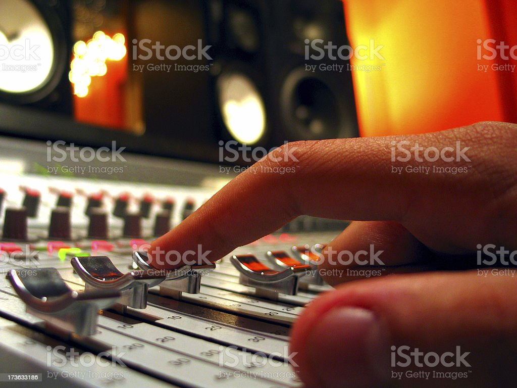 Finger on Audio Console Fader royalty-free stock photo