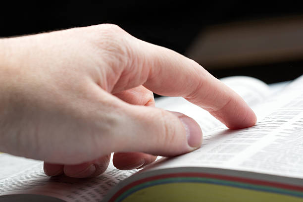 Finger on book stock photo